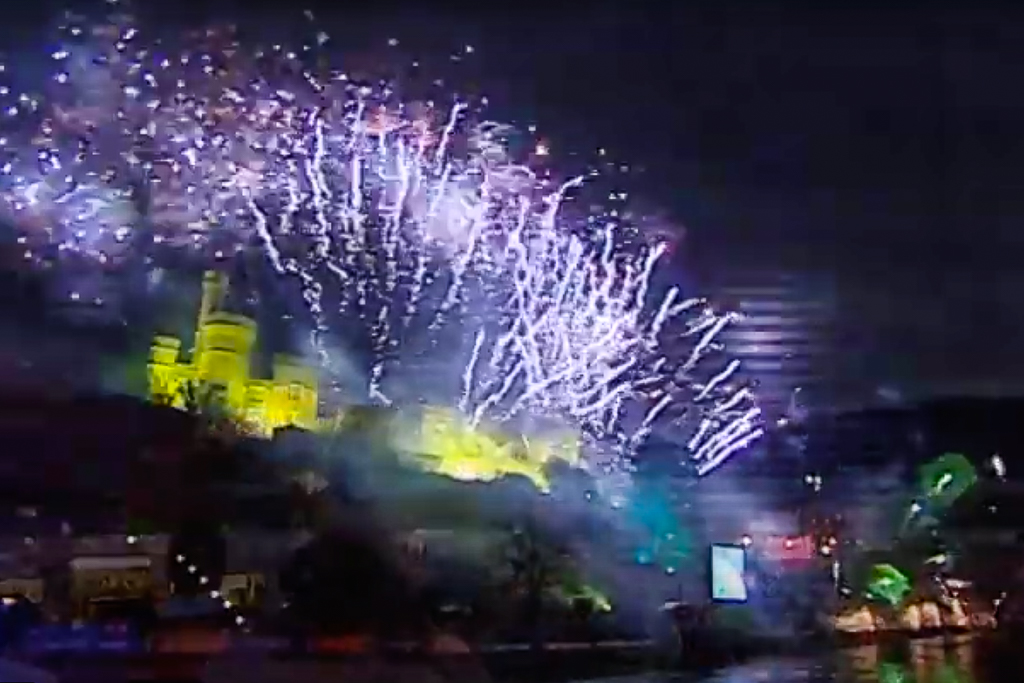 An still from the Inverness City Video showing an impressive firework display over Inverness Castle with the reflections on the River Ness below.