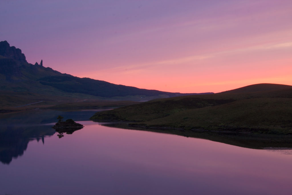 Image of Sunrise over The Old Man of Storr on The Isle of Skye in The Scottish Highlands. Beautiful sunrise over Loch Leathan.