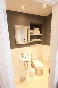 Picture of the King Room 1 Shower Room ensuite, showing the WC and wash hand basin.