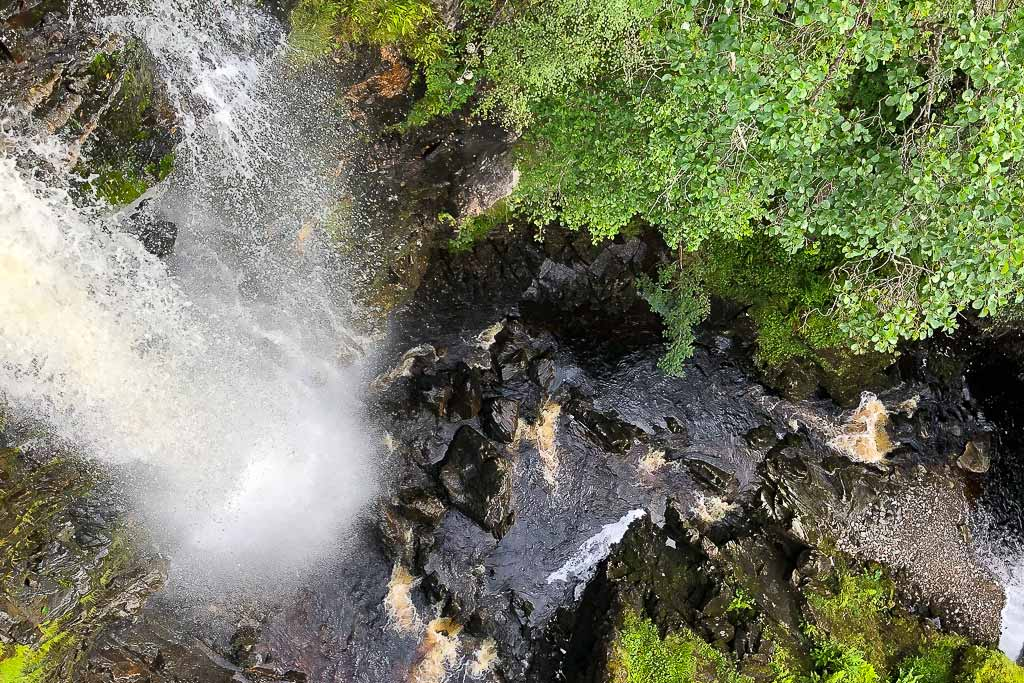 Waterfall viewed from above at Plodda falls, in Glen Affric, Scottish Highlands,