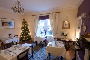 The breakfast room at The Ness Guest House with beautifully decorated Christmas tree and festive decorations